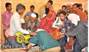 Muslim man helps in Murti Astapan prayers at a temple in Srinagar